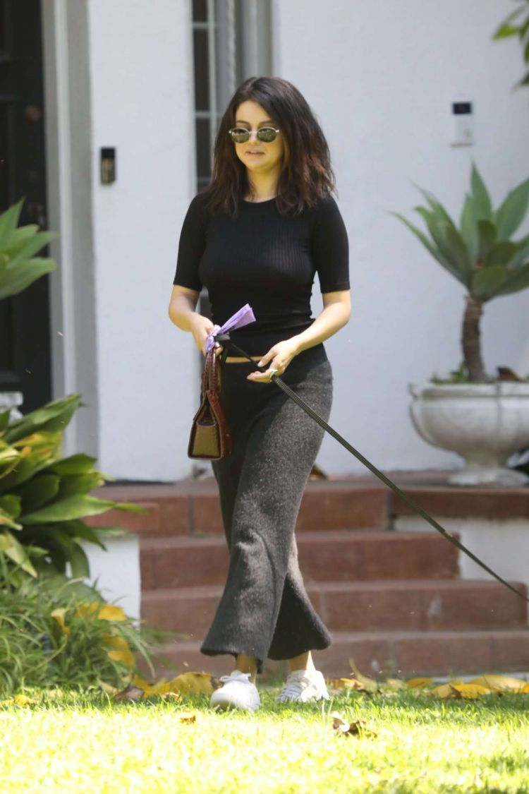 Selena Gomez Walking Her Dog Out In Los Angeles