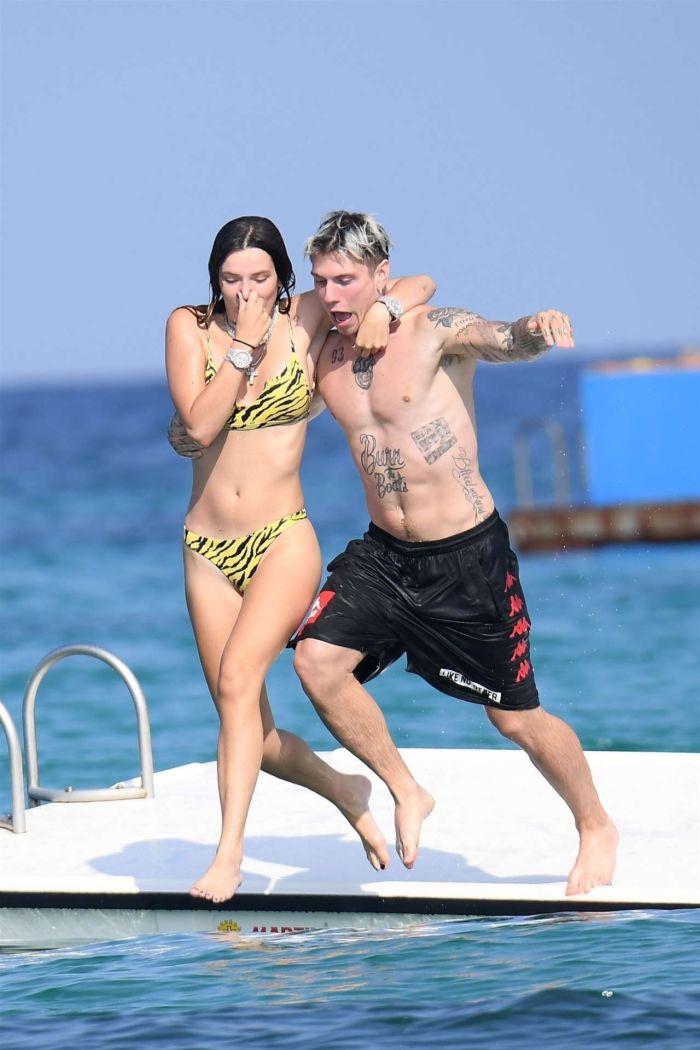 Bella Thorne Vacationing In A Tiger Bikini On The Beach In Sardinia